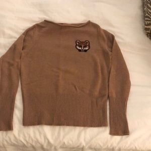 Tory Burch sweater with beaded fox patch